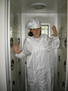 Visitor From USA Going Into Clean Air Room With Uniform Before Inspecting Factory
